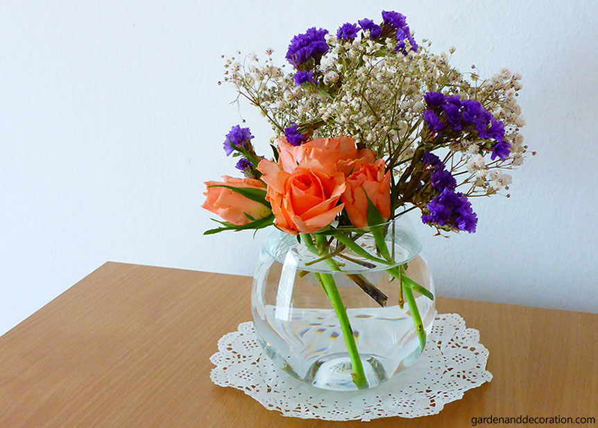 Combination of different flowers in a small vase