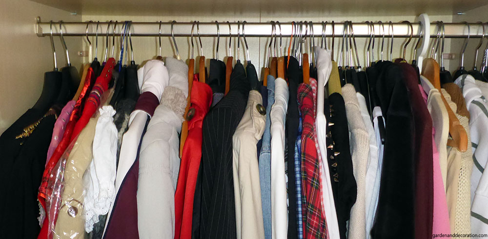 Cluttered closet with too many clothes