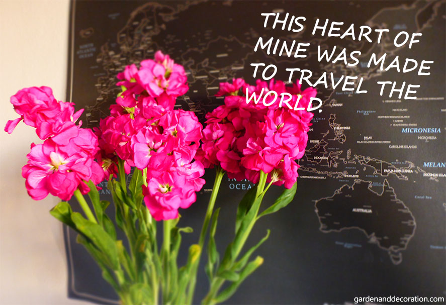 flower arrangement in front of world map