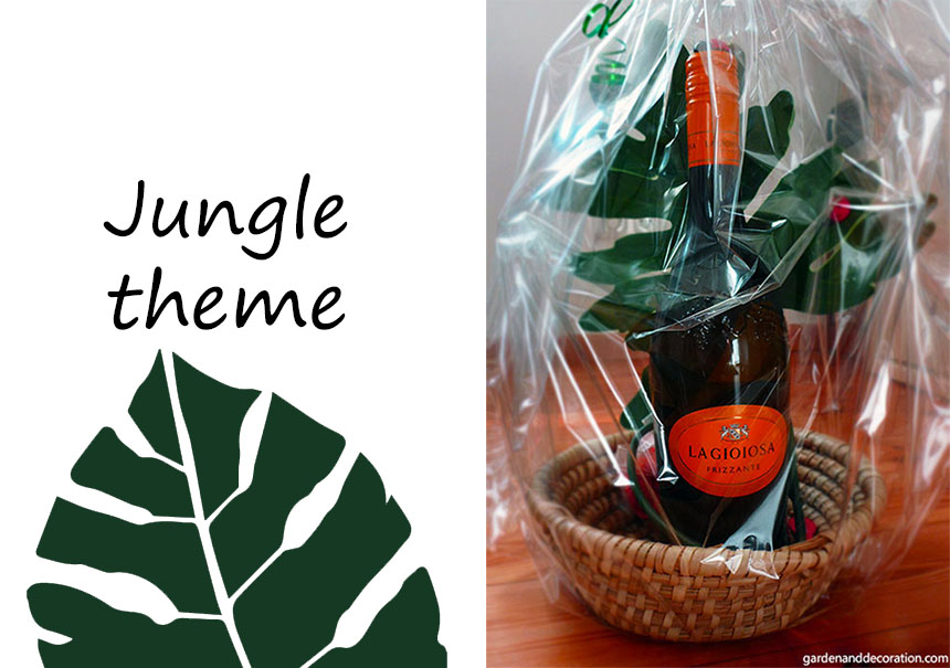 Jungle themed gift wrapping idea with a wine bottle and artificial leave