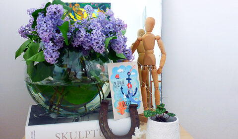 Freshly cut lilacs to brighten up a small nightstand