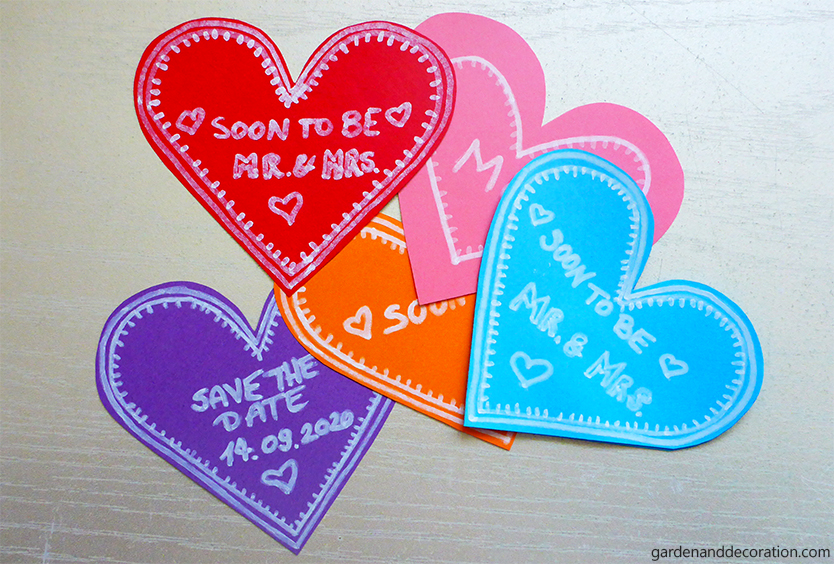 Small paper hearts as wedding invitations