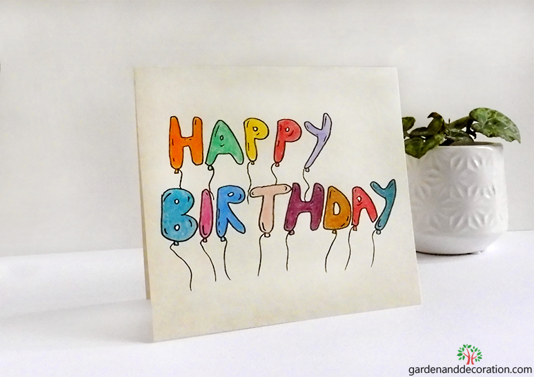 Happy birthday card with colourful balloons by gardenanddecoration.com